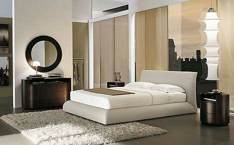 Elegant-bedroom-with-gray-floor-handing-lamps-wood-drawers-cabinets-and-white-bed