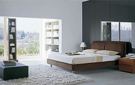 Sample-bedroom-with-beige-floor-carpet-gray-white-lamps-and-night-lamps