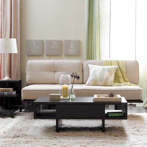 Sample-light-living-room-with-black-table-light-carpet-white-cream-sofa-and-white-night-lamp-drapery