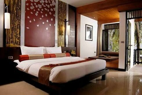 Elegant-bedroom-in-exotic-style-with-light-floor-handing-lamps-and-red-wallpaper