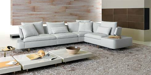 Contemporary-living-room-with-gray-white-floor-with-beige-carpet-and-stone-walls