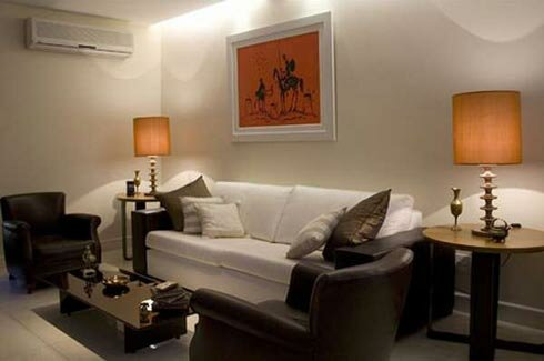Living-room-in-sample-style-with-white-sofa-night-stand-and-picture-of-walls-and-glass-top-table